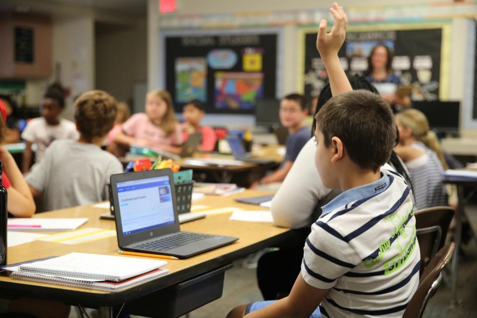 student raising his hand