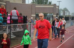Principal Bob Thompson leads the walk-a-thon